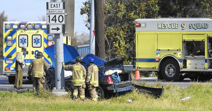 Police and emergency personnel work at the scene of a crash at the intersection of Md. 140 and Md. 91 in Finksburg Saturday, October 29, 2016. The crash was reported around 11:30 am.