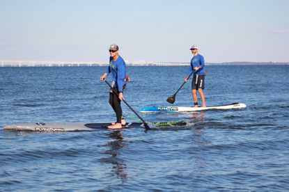 Chris Hopkinson, right, will paddle the length of the Chesapeake Bay in September. - Original Credit: ORP