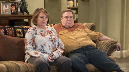 "Roseanne Barr, left, and John Goodman appear in a scene from the reboot of ""Roseanne,"" which pulled in 18.2 million viewers for its premiere."