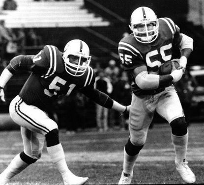 Baltimore Colts linebacker Barry Krauss picks up a fumble and is flanked by Rick Jones on the return.