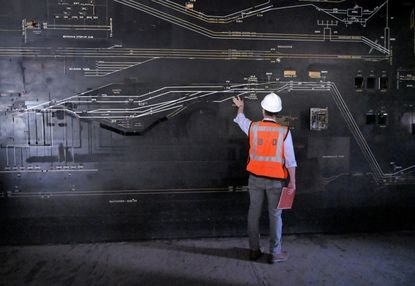 Charlie Bond, senior development director of Beatty Development stands in the second level railroad control room which has been dismantled at Baltimore's Pennsylvania Station Wed., Sept. 22, 2021. The school long ago had shuttered. (Karl Merton Ferron/Baltimore Sun Staff)