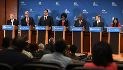 Democratic candidates for governor share the stage during a debate at the University of Baltimore Tuesday. From left to right are: Jim Shea, Richard S. Madaleno Jr., Ben Jealous, Valerie Ervin, Rushern Baker, Alec Ross, Krish Vignarajah.