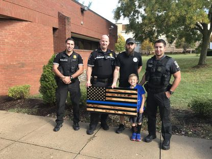 A wooden thin blue line flag was presented to Montgomery County Police officers on Oct. 30.