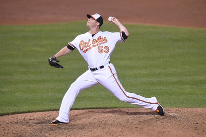 Zach Britton of the Baltimore Orioles pitches in the ninth inning for his 33rd save during a baseball game against the Texas Rangers at Oriole Park at Camden Yards on Aug. 3, 2016 in Baltimore.