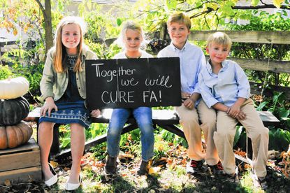 With the help of her parents, Kristin and Ben, her siblings and other family members, and the Towson community, 11-year-old Anna Morrow, left, is fighting the rare genetic disorder, Friedreich's Ataxia. She is pictured here with, from left, siblings Maggie, Patrick and Sam, at an October event that raised money toward finding a cure for the disease.
