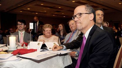 Tom Perez, chairman of the Democratic National Committee, seated as he is introduced by U.S. Sen. Ben Cardin at an event last year in Anne Arundel County.
