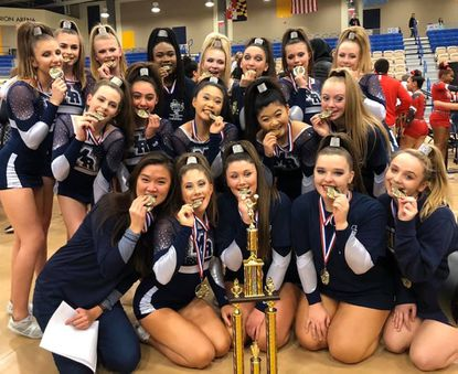 The Marriotts Ridge cheerleading team poses for a photo after winning the Class 1A/2A state championship on Tuesday, Feb. 11, at Harford Community College.
