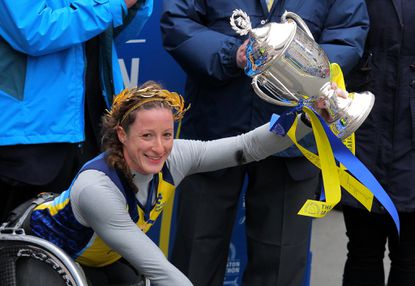 Tatyana McFadden celebrates after winning the women's push rim wheelchair division of the 119th Boston Marathon.