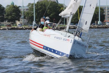 Skipper Jim Hayes steers one of the Beneteau First 22A sloops during the Don Backe Memorial Regatta.