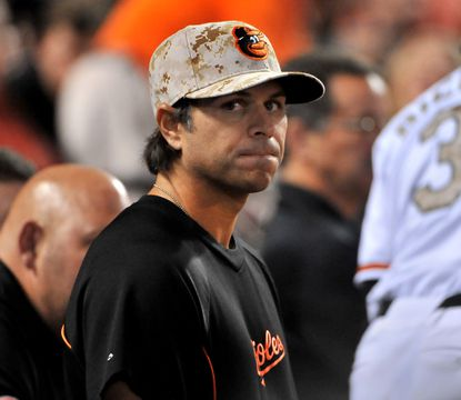Brian Roberts looks on from the dugout during Friday night's game.