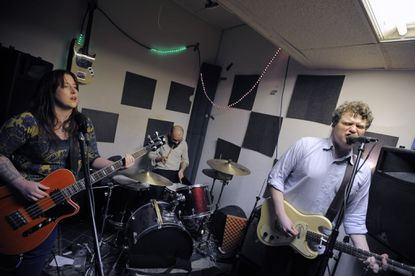 L-R: Tracey Buchanan, Adam Smith and Yuri Zietz of Monster Museum play a new song in their Remington practice space on March 12, 2015.