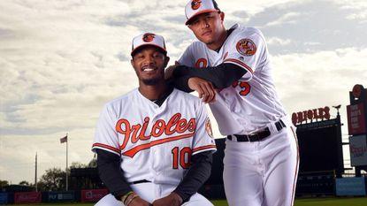Orioles' Adam Jones and Manny Machado at the Ed Smith Stadium complex in Sarasota, Fla.