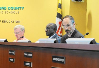 Harford County school board member Robert Frisch, right, expresses his concerns Monday about eliminating 36 teaching positions to help balance the school system's fiscal 2018 operating budget.