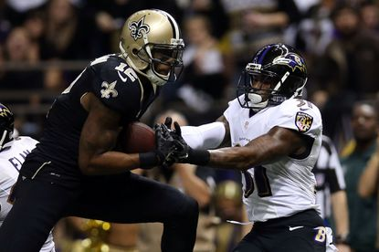 Marques Colston catches a touchdown pass in front of Terrence Brooks during the second quarter Monday night.