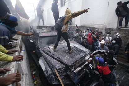 Anti-government demonstrators commandeer an armored vehicle during a nationwide strike against President Lenin Moreno and his economic policies, in Quito, Ecuador, Wednesday, Oct. 9, 2019.