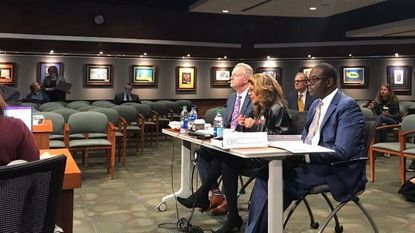 From left, Howard County schools Superintendent Michael Martirano, school board Chairwoman Mavis Ellis and Rafiu O. Ighile, the school system's chief financial officer, discuss the school district's operating budget at a work session with County Council in May. (Jess Nocera / Baltimore Sun Media Group)