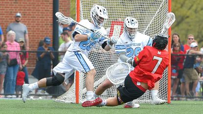 Maryland midfielder Tim Rotanz scores a goal as he dives to the ground Saturday. The Terps won. 8-7, in triple overtime.