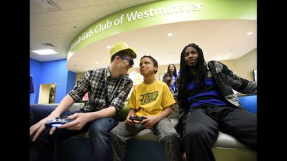 Elijah Jones, center, plays video games with junior staffer Isaac Jones, left, and intern Breon Herbert at the Boys and Girls Club's Westminster location April 9, 2018. The club will implement a pilot after-school program for middle school students in northern Carroll County.