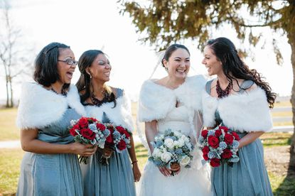 June Struder and her bridesmades all wore white faux-fur wraps for Struder's December wedding to Joseph Whalen.