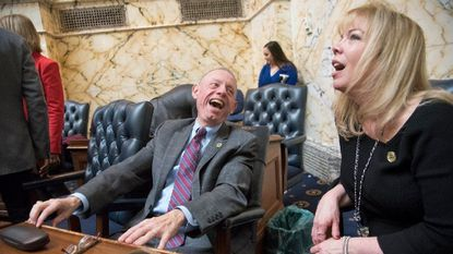 Carroll County Delegate Haven Shoemaker laughs with Carroll County Delegate April Rose at the opening of the General Assembly in Annapolis.