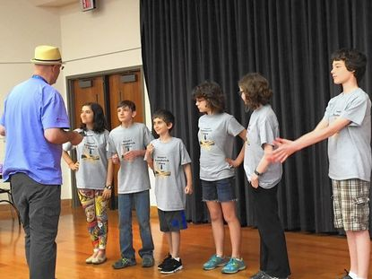 Jessica Balick Goodman, Owen Pruit, Henry Balick Goodman, Olivia Merryman, Molly Pruit and Ethan Pound are given instructions before their improv skit.