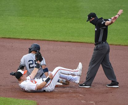 New York Yankees shortstop Gleyber Torres (25) slides safe when Baltimore Orioles short stop Pat Valaika can't make the tag quick enough. The New York Yankees travel to Camden Yards to play the Baltimore Orioles on Wednesday, April 28, 2021.