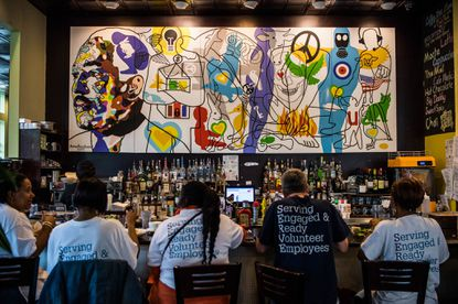 A mural hangs above the bar at a Busboys and Poets in Washington on May 16, 2018.