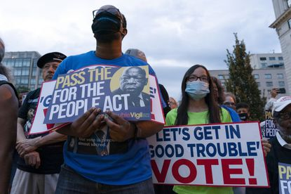 People hold placards during a rally in support of voting rights, at Black Lives Matter Plaza in Washington, Saturday, July 17 2021. (AP Photo/Jose Luis Magana)
