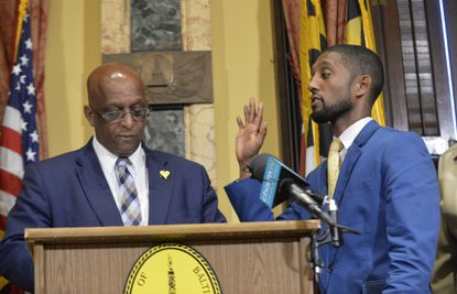"""Baltimore Mayor Bernard C. """"Jack"""" Young and City Council President Brandon Scott (right), shown here at Scott's swearing in, declined to attend a town hall Tuesday night hosted by WBFF-TV."""