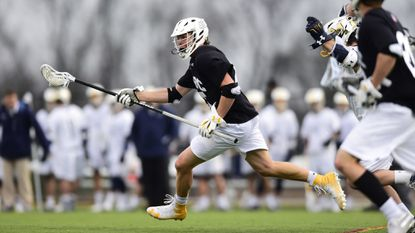 UMBC sophomore defenseman Nick Griffin, a Liberty graduate, helped the Retrievers upset top-ranked Albany on April 6 at UMBC Stadium in Catonsville.