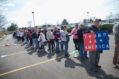 Supporters of Republican presidential candidate Donald Trump wait in line to enter a campaign rally at the Holiday Inn Express hotel on March 29, 2016, in Janesville, Wis.