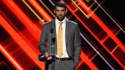Michael Phelps accepts the award for Record-Breaking Performance at the ESPYS at the Microsoft Theater on Wednesday, July 12, 2017, in Los Angeles.