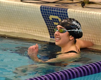 Patterson Mill's Katerina Lomis smiles and pumps her fist after realizing she had broken a regional record with a time of 2:15.55, in the Women's 200 Individual Medley race during Saturday's Class 1A-2A-3A North Region swim championship meet at Magnolia Middle School.