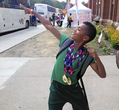 Ace Valentine shows off his gold medals in the 400-meter dash and long jump from the AAU Junior Olympics Games in Des Moines, Iowa.