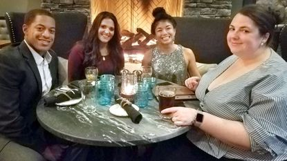 Jordan and Michaelan Watkins, Rhea Torreau and Liz Murphy sit beside the fire during the VIP opening of Blackwall Barn and Lodge Saturday. The new restaurant officially opened Monday.
