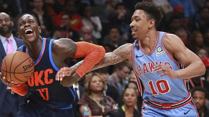 Atlanta Hawks guard Jaylen Adams defends Oklahoma City Thunder guard Dennis Schroder during a game Jan. 15, 2019, at State Farm Arena in Atlanta.