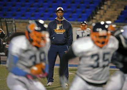 First-year Morgan State football coach Lee Hull leads his team in practice in in Richmond, Va., on Nov. 24, 2014.