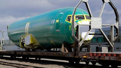 A Boeing 737 fuselage bound for the company's production facility in nearby Renton, Wash., waits April 9, 2019, on a flatcar at a rail yard in Seattle. Two deadly crashes of the Boeing 737 Max jet have taken a toll on the company's business.