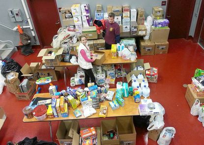The Susquehanna Hose Company, of Havre de Grace, is collecting relief supplies for firefighters and their families in New York and New Jersey, some of whom were left homeless by Sandy. On Thursday, Brian and Lisa Minutoli help organize and pack items to be shipped to those affected by the storm.