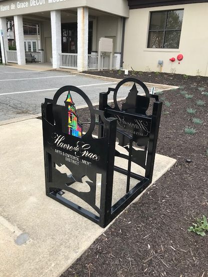 Bike racks designed by local artist Bill Watson have been installed throughout the Havre de Grace Arts and Entertainment District. Each rack is adorned with the Arts & Entertainment District logo and a unique design depicting a specific genre of the arts. This one is located outside the Decoy Museum.