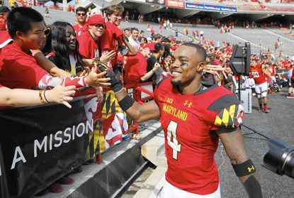 Maryland defensive back William Likely greets fans after an NCAA college football game against Richmond, Saturday, Sept. 5, 2015, in College Park, Md. Maryland won 50-21. (AP Photo/Patrick Semansky)