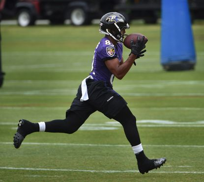 Ravens wide receiver Keenan Reynolds makes a catch during minicamp at Under Armour Performance Center.