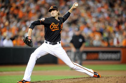 Left-hander Andrew Miller delivers in the eighth inning against Seattle at Camden Yards.