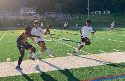 Catonsville's Emmanuel Amoako dribbles around Oakland Mills Sebastian Fonseca in the Comets' 2-0 victory on Thursday.