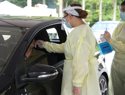 Jaclyn Phelps, a registered nurse, administers a coronavirus test Thursday, July 23, 2020, at the Anne Arundel County Health Department headquarters in Annapolis.