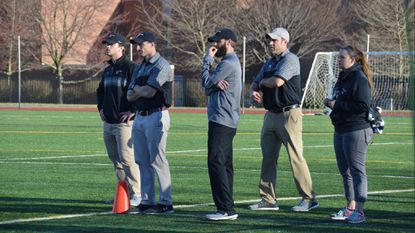 Jeff Shirk (second from the right), the coach of the Washington College men's lacrosse program, was left to wonder what could have been if the Shoremen had pulled off an upset of 2017 NCAA Division III champion Salisbury on March 17.