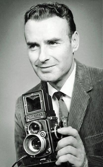 Lloyd Pearson, a veteran Baltimore Sun photographer whose iconic image of yellow and green Mayflower moving vans rolling the Baltimore Colts out of town during a midnight snowstorm earned him lasting fame, died New Year's Day from complications of cancer at Gilchrist Hospice Care in Towson. The longtime Overlea resident was 90.