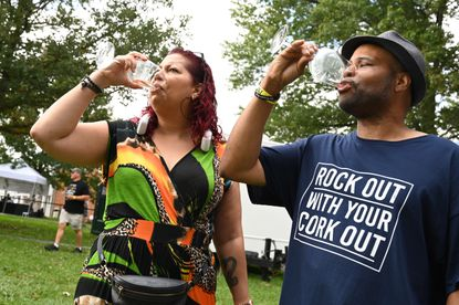 Windsor Mill residents Rachel and Wilson Turner enjoy a white wine sample from a vineyard during the Maryland Wine Festival at the Carroll County Farm Museum on Saturday, Sept. 18, 2021.