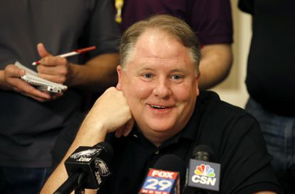 Philadelphia Eagles head coach Chip Kelly smiles as he listens to a question as NFC football coaches meet with the media during the NFL's annual meeting, March 25 in Phoenix.