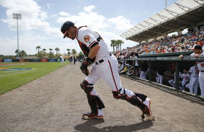 Orioles catcher Matt Wieters jogs onto the field before a spring training game against the Boston Red Sox in Sarasota, Fla., Tuesday, March 8, 2016.